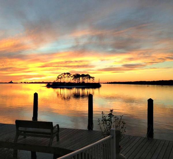 Sunset view from the dock at Pirates' Bay Guest Chambers & Marina in Fort Walton Florida