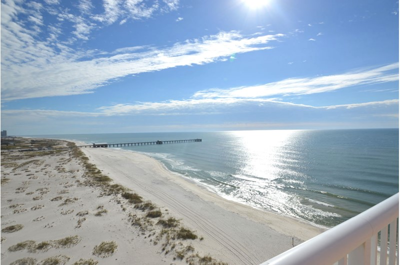 See down the coastline off your balcony at Royal Palms in Gulf Shores AL