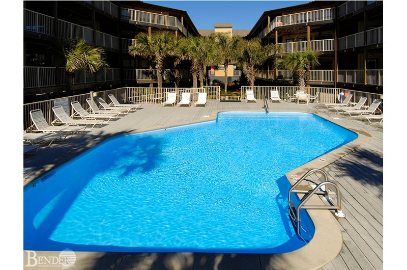 Enjoy a swim in the gorgeous blue pool water at Sandpiper in Gulf Shores AL