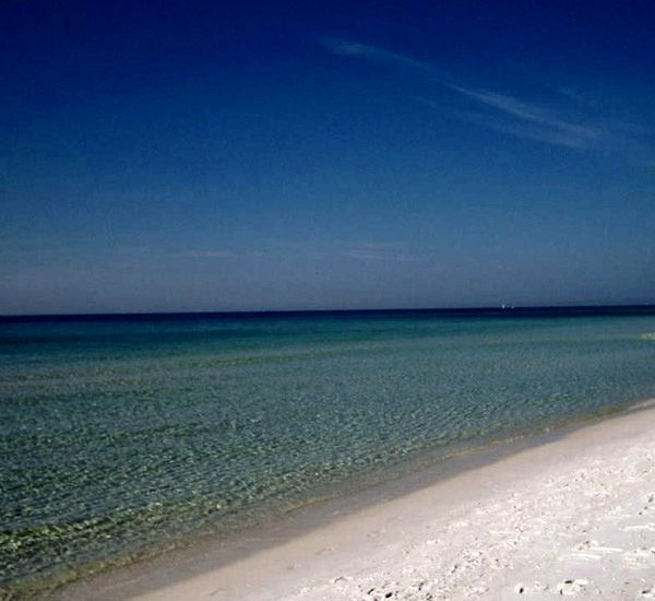 Beach is right across the street from Sandpiper Cove in Destin Florida