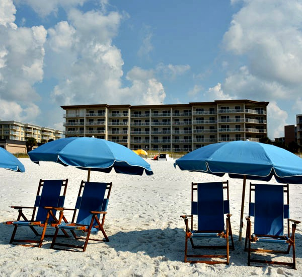 Beach chairs and umbrellas at Summer Place in Fort Walton Beach FL
