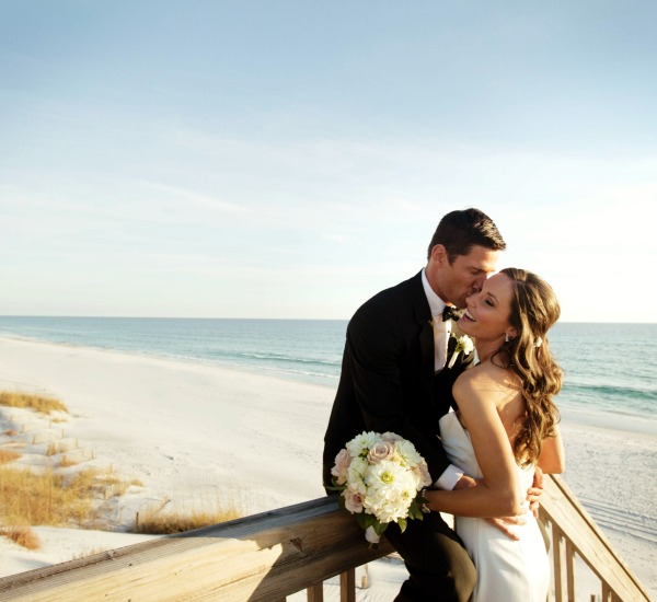 bride and groom on Santa Rosa Beach Florida at WaterColor Inn and Resort